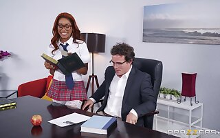 Ebony babe Jenna Foxx fucked and facialized in a school girl's outfit