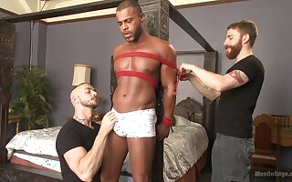 Tied up black dude gets his dick sucked and his asshole penetrated