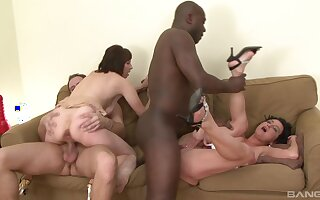 Wives shares by their men in merciless foursome on a couch