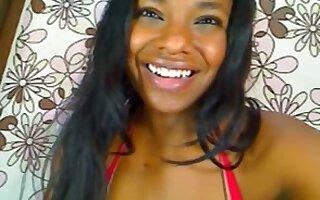 Latina black candy fingering on cam