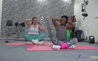 Lesbian interracial coitus on a difficulty gym floor with appealing Lola Marie
